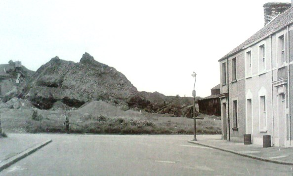 Aberdyberthdi street in 1963 with Copper slag tip behind