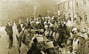 Street Party in Aberdyberthdi street 1936 with Copper slag-tip behind