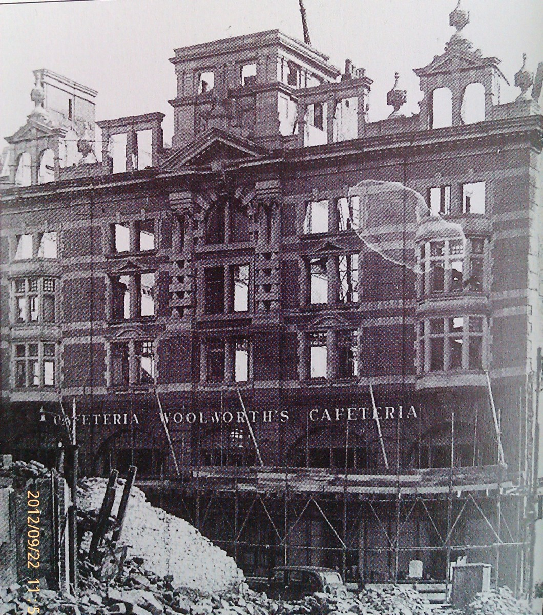 a very badly damaged Woolworths Store in Swansea's High Street following the Blitz of the town.